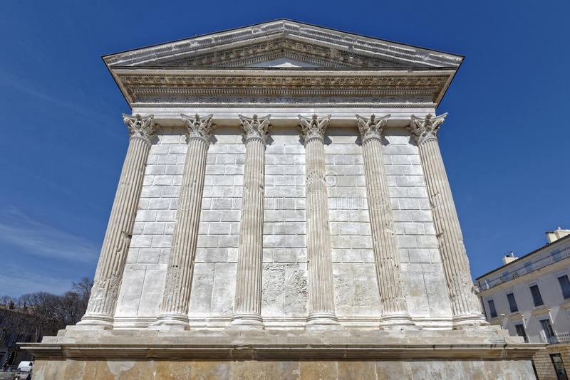 Nimes, france: Roman temple, Maison Carree. Image taken of the rear of the roman temple Maison Carree in Nimes, France, Europe royalty free stock image