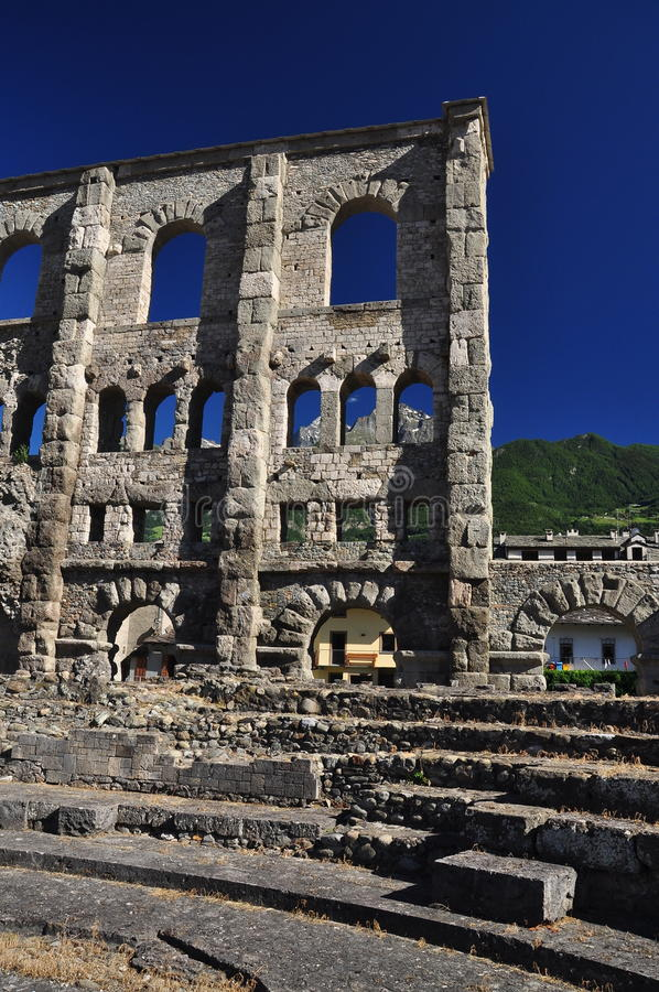 Roman theatre ruins in the city of Aosta, Italy. Roman theatre and ruins in the city of Aosta, Aosta Valley ( Valle ) Italian Alps royalty free stock photography