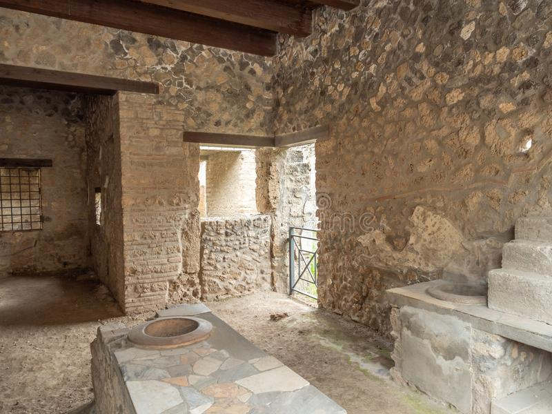 Roman thermopolium in Pompeii, Italy. World Heritage List. Distinctive masonry counter in the interior of ruined Roman shop in the ancient city of Pompeii, near royalty free stock image
