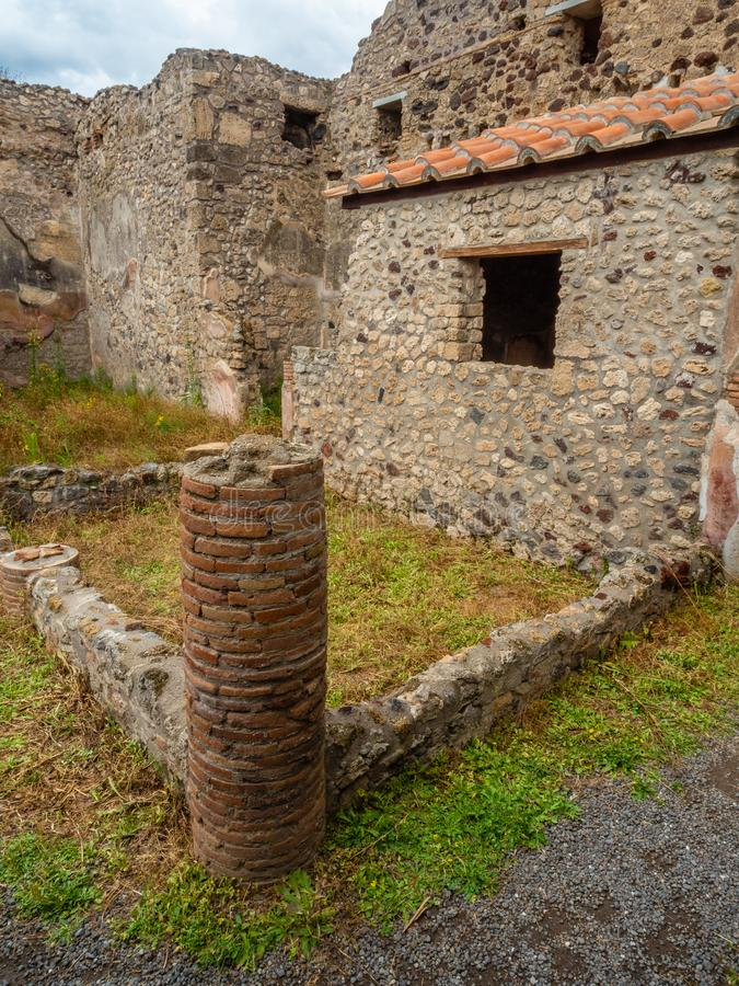 Roman villa in Pompeii, Italy. World Heritage List. Interior of ruined Roman villa in the ancient Roman city of Pompeii, near modern Naples in Italy. Cloudy royalty free stock images