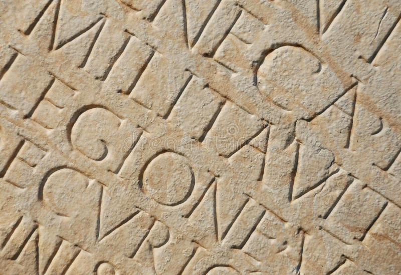 Roman Writing as Background stock images