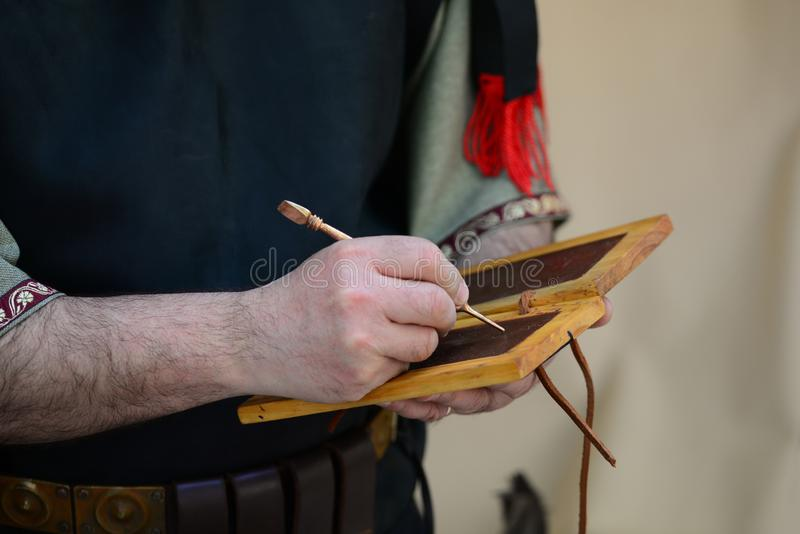 Roman writing on wax tablet royalty free stock photography