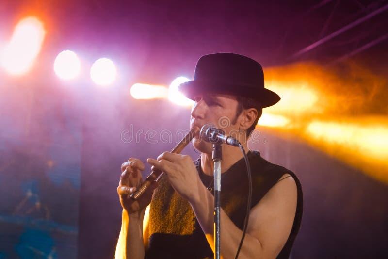 Roman Yagupov, Moldovian folk rock group Zdob si Zdub singer, plays flute, live concert in Nemyriv, Ukraine, 21.10.2017, editorial. Roman Yagupov, lead singer of royalty free stock photo