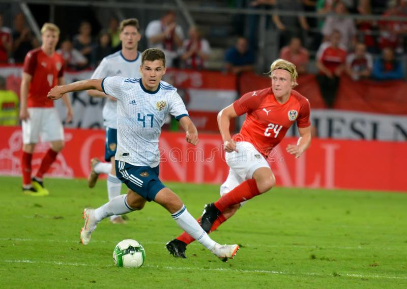 Roman Zobnin against Austrian midfielder Xaver Schlager. Innsbruck, Austria - May 30, 2018. Russian midfielder Roman Zobnin against Austrian midfielder Xaver stock photography