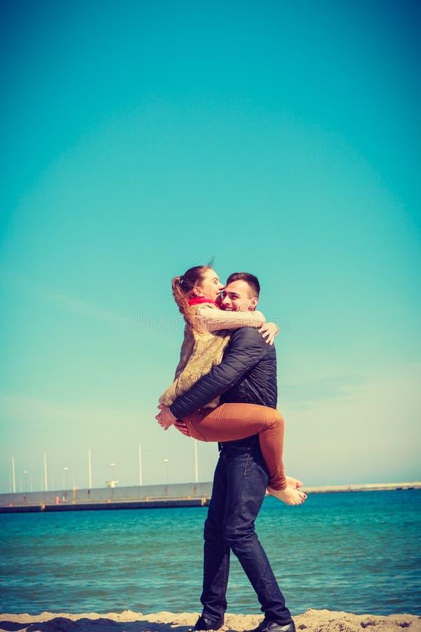 Happy couple having date on beach stock image