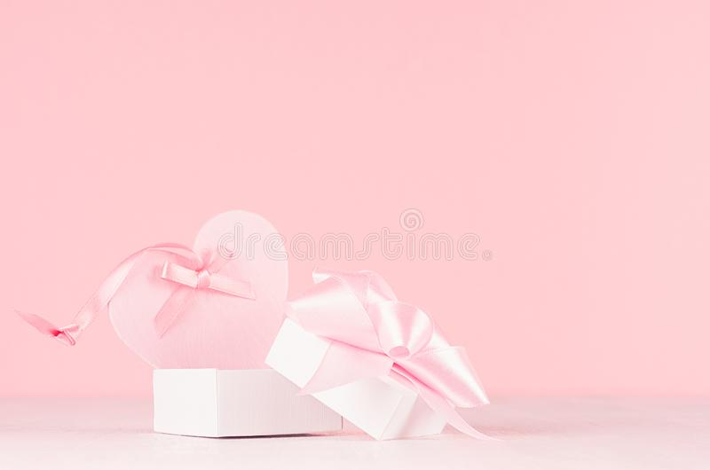Romance celebration background for Valentine and wedding - cute heart with silk ribbon and gift box on white wood board. stock photos