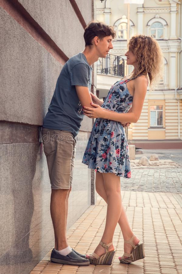 Lovers embraced and chatting in the old street of the city. Romance dating. Lovers embraced and chatting in the old street of the city royalty free stock photography