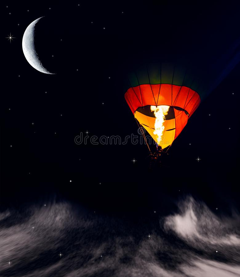 Romance of the flight . Aerostat at night. Night sky and young month . Flying ball in the air royalty free stock photography