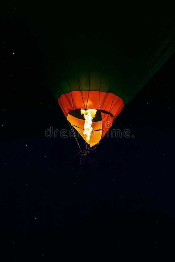 Romance of the flight . Aerostat at night. Night sky and young month . Flying ball in the air royalty free stock photo