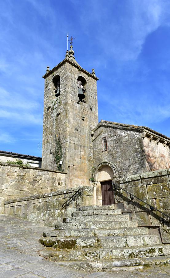 Romanesque medieval San Esteban Church. Facade, bell tower and stone stairs. Allariz, Orense, Spain. royalty free stock photos
