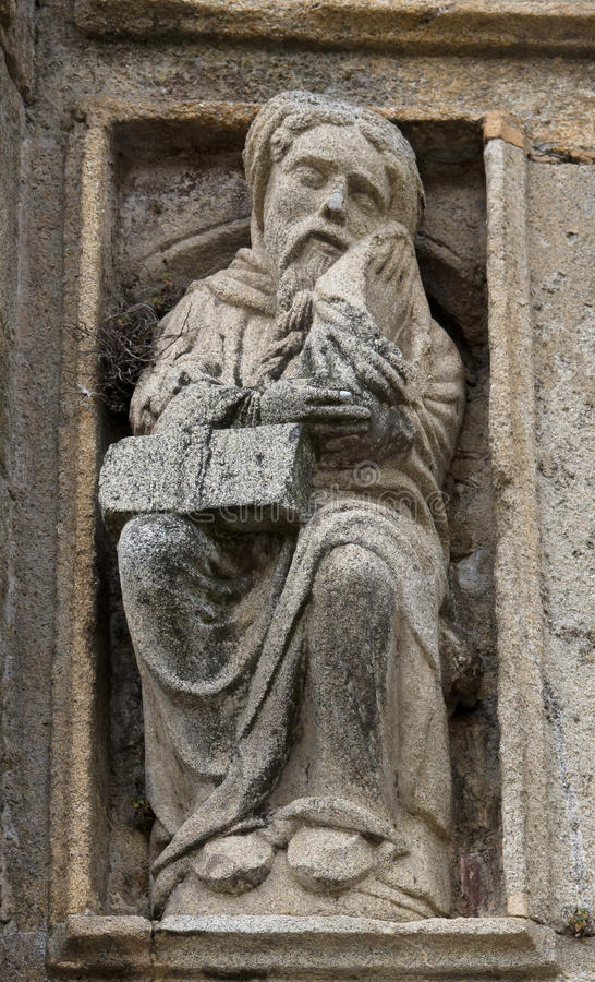 Romanesque old man in Holy Portal. In Santiago de Compostela cathedral royalty free stock photography