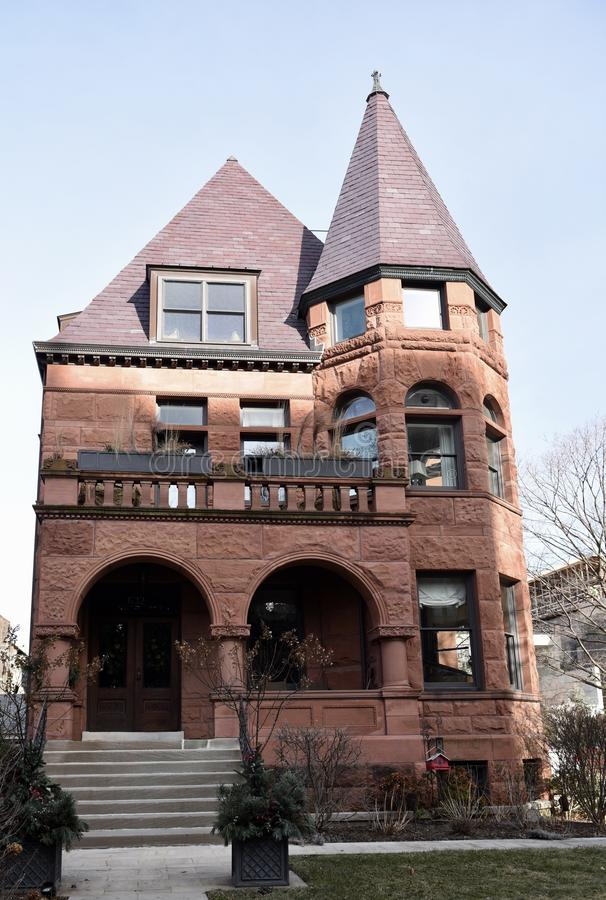 Romanesque Revival Mansion. This is a Winter picture of a large Brownstone Mansion located in the Lincoln Parl neighborhood of Chicago, Illinois. This Mansion stock photos