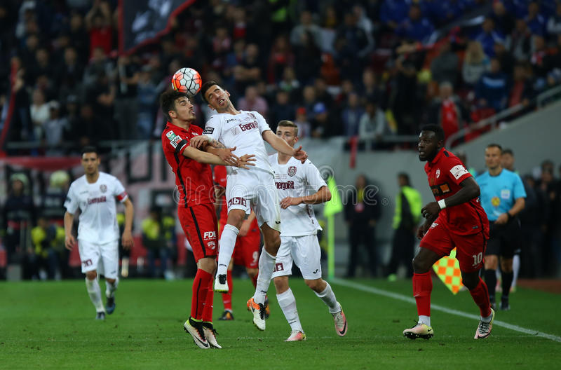 Romania's Cup Final: Dinamo Bucuresti vs. CFR Cluj. CFR Cluj holds the Romania's Cup after winning on penalty shootout against Dinamo Bucharest in the stock photos