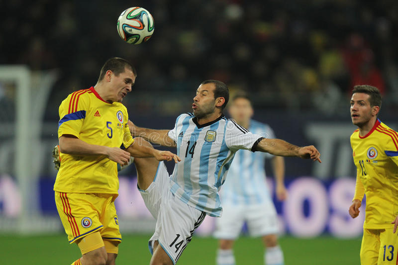 Romania - Argentina football/soccer game. Javier Alejandro Mascherano (Argentina) and Alexandru Bourceanu (Romania) pictured in action during the friendly stock image