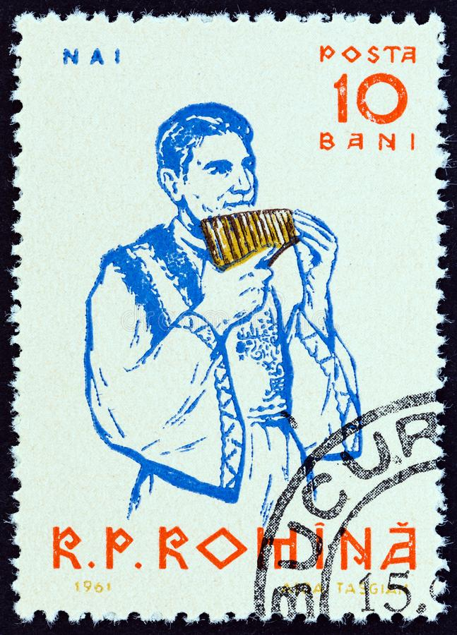 ROMANIA - CIRCA 1961: A stamp printed in Romania shows  Pan flute player, circa 1961. royalty free stock images