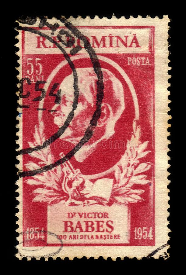Romanian scientist and microbiologist Victor Babes. ROMANIA - CIRCA 1954: A stamp printed in Romania shows portrait of a romanian scientist and microbiologist stock image