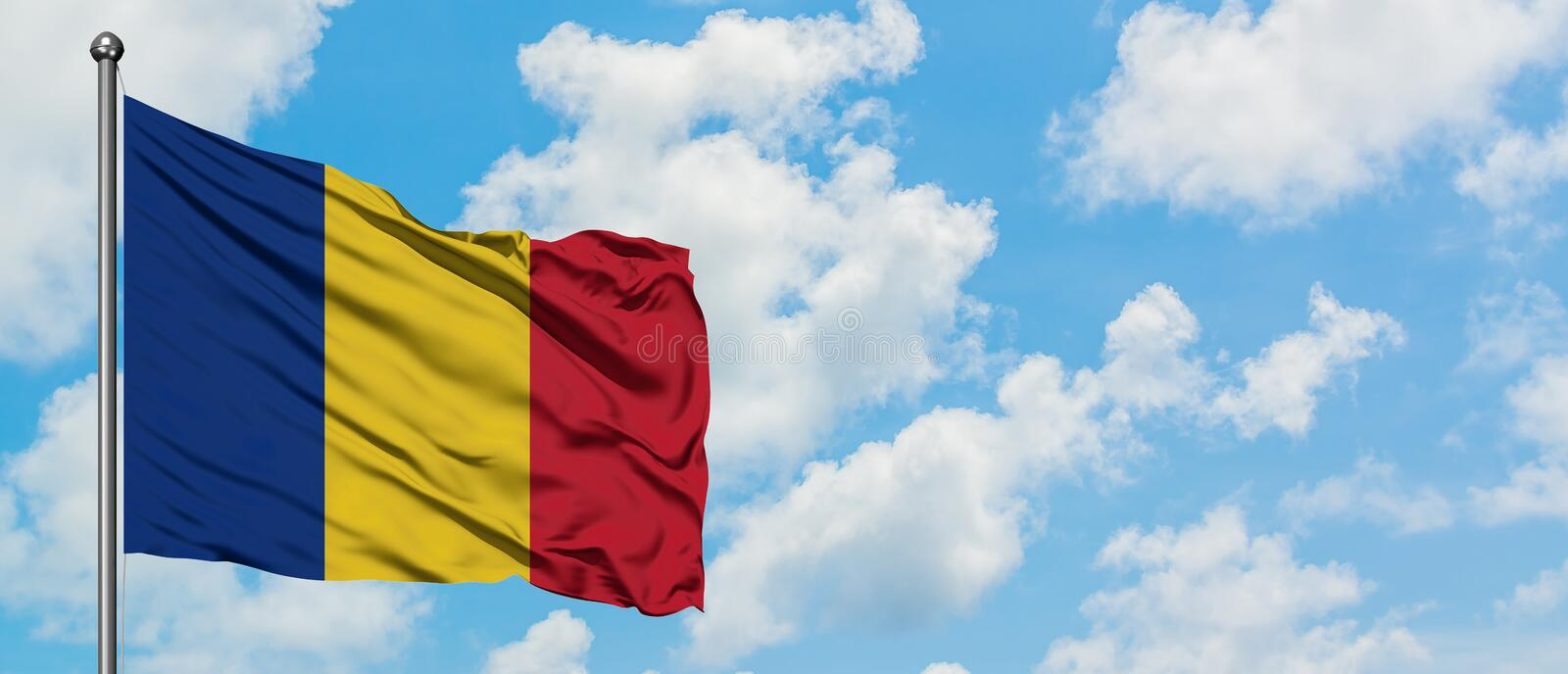 Romania flag waving in the wind against white cloudy blue sky. Diplomacy concept, international relations.  royalty free stock images