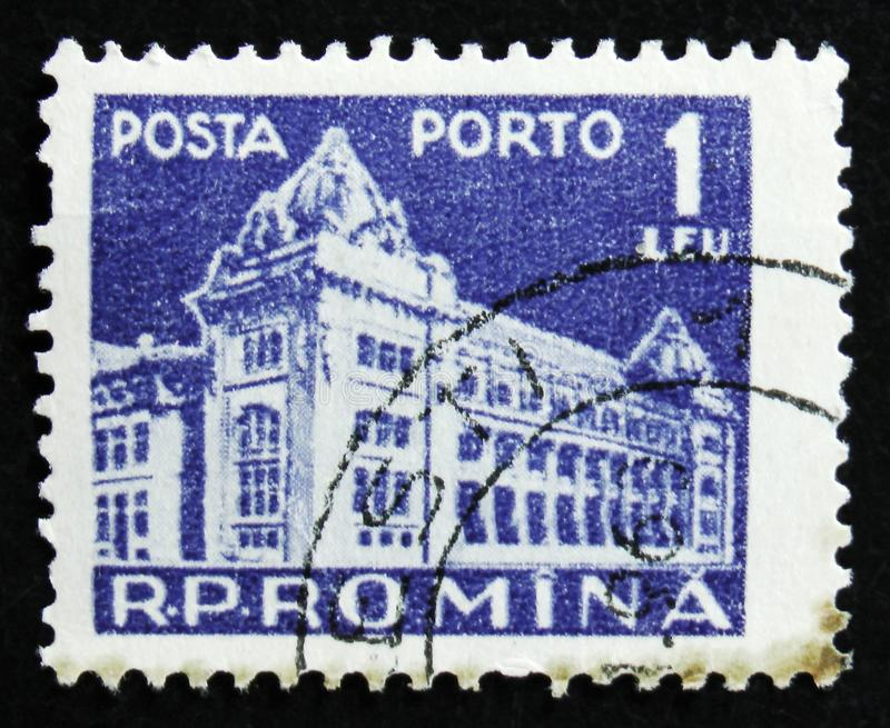 Romania stamp shows Central Post Office building, Bucharest, circa 1967. MOSCOW, RUSSIA - APRIL 2, 2017: A post stamp printed in Romania shows Central Post royalty free stock photos