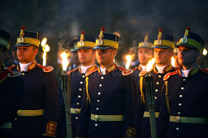Romanian Army Day celebrations. Bucharest, Romania - October 25, 2012: Romanian honor guard soldiers march with torches during the Romanian Army Day celebration royalty free stock images