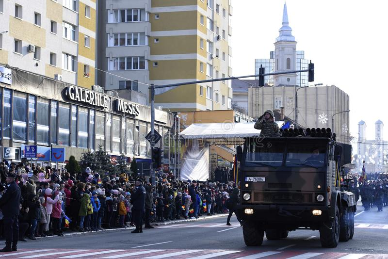 Romanian army parade in Zalau, Romania. December 1, 2018: Army trucks with saluting soldiers at the parade for Romania`s national Day, December 1, in Zalau stock photos