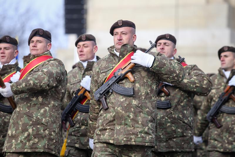 Romanian army soldiers are armed with AK-47 assault rifles. Bucharest, Romania - December 1, 2018: Romanian army soldiers, armed with AK-47 assault rifles, take royalty free stock photography