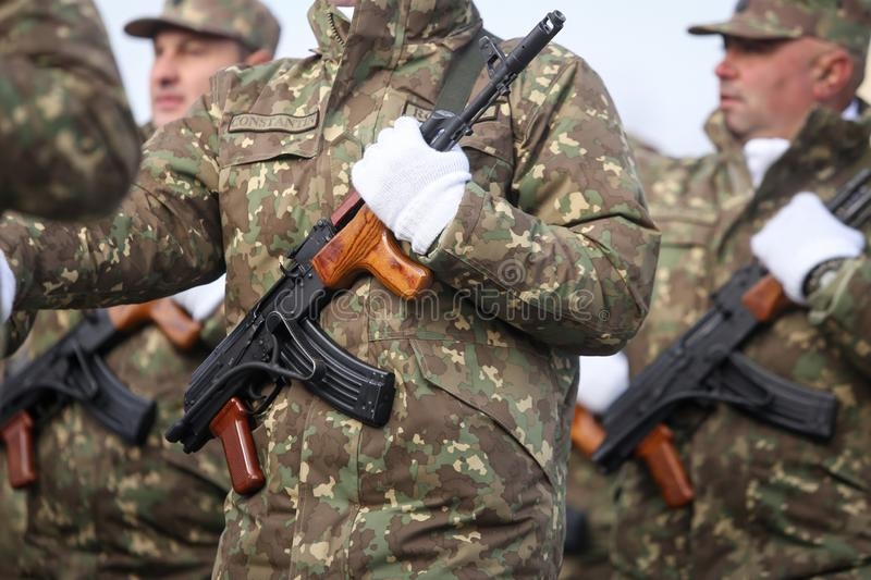 Romanian army soldiers are armed with AK-47 assault rifles. Bucharest, Romania - December 1, 2018: Romanian army soldiers, armed with AK-47 assault rifles, take royalty free stock photo