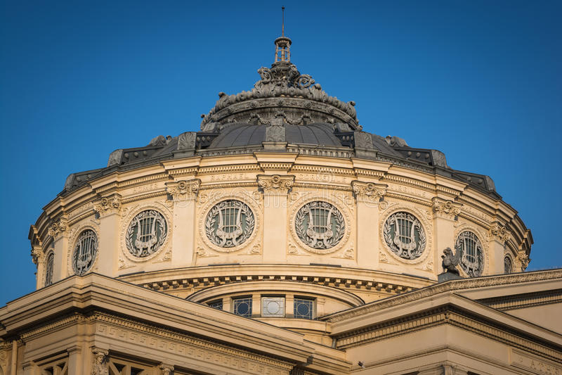 Romanian Athenaeum, ancient building in Bucharest, Romania. It's a concert hall important for Romanian culture. Photo was taken in a sunny day with blue sky royalty free stock photography