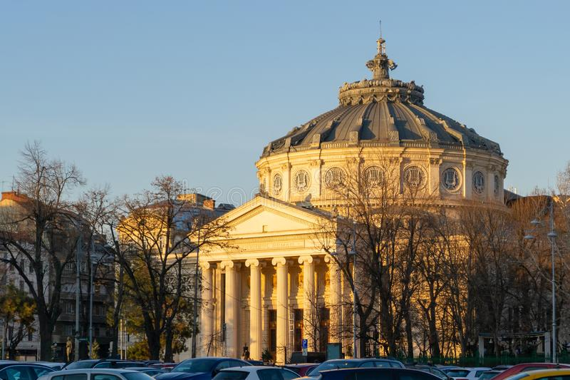 Romanian Athenaeum Ateneul Roman in Bucharest, Romania, as seen from across the street, at sunset, with warm light. Romanian Athenaeum Ateneul Roman in stock photos