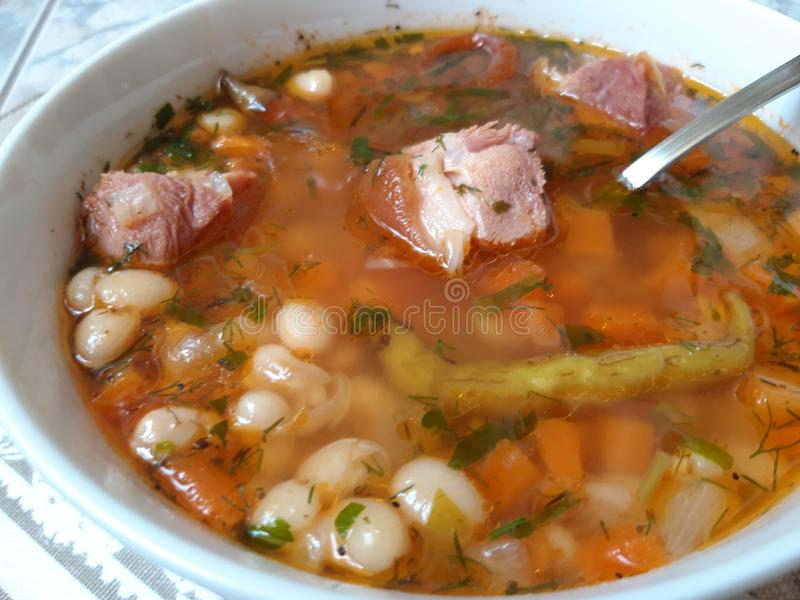 Romanian Bean Soup with Smoked Pork Meat stock images
