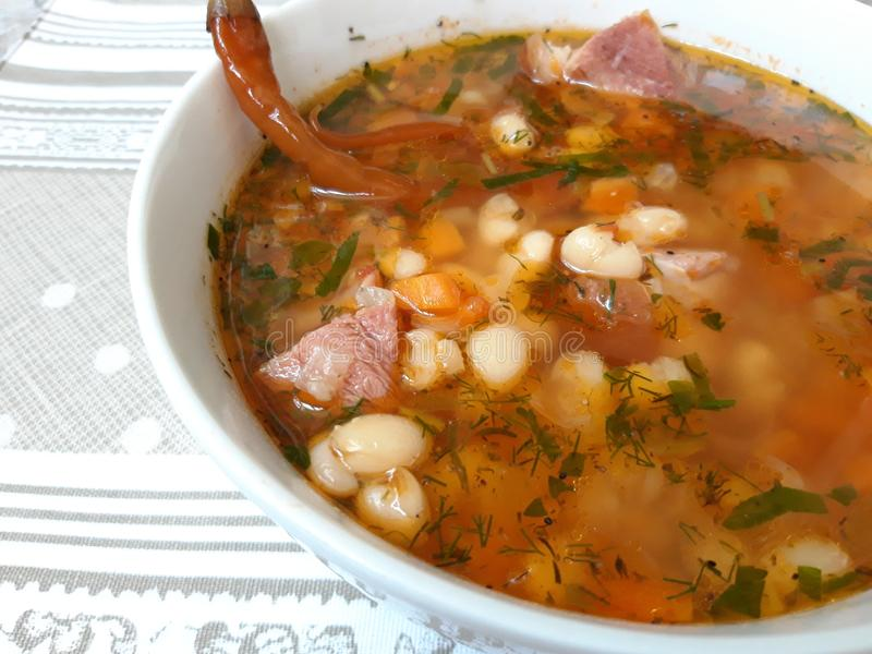 Traditional Romanian Bean Soup with Smoked Pork Meat stock photography