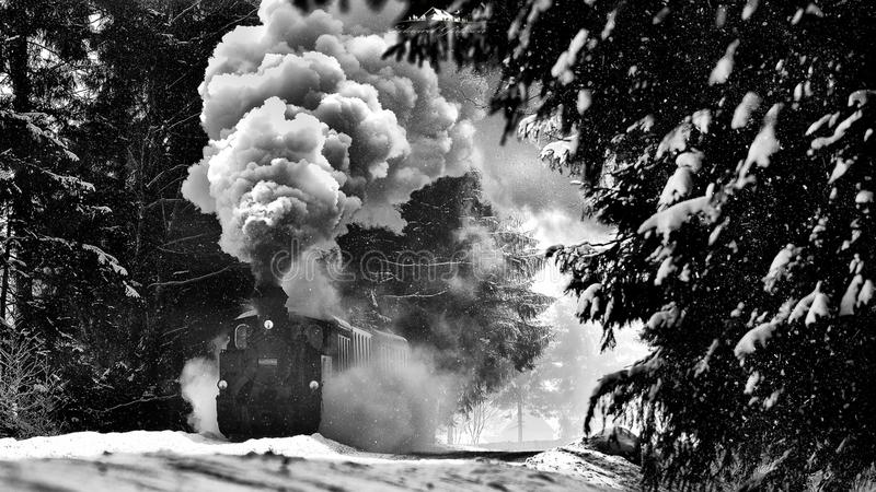 Romanian Bucovina landscape with old steam train in the winter time royalty free stock photography