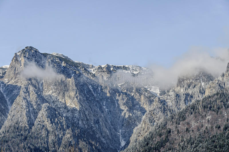 Romanian Carpathian mountains, Bucegi range with clouds. Snow and fog, winter time landscape stock images