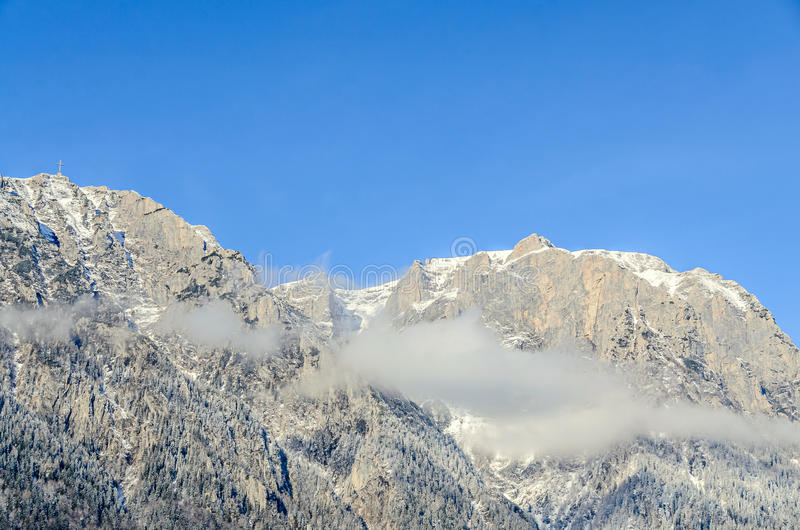 Romanian Carpathian mountains, Bucegi range with clouds. Snow and fog, winter time landscape royalty free stock photos
