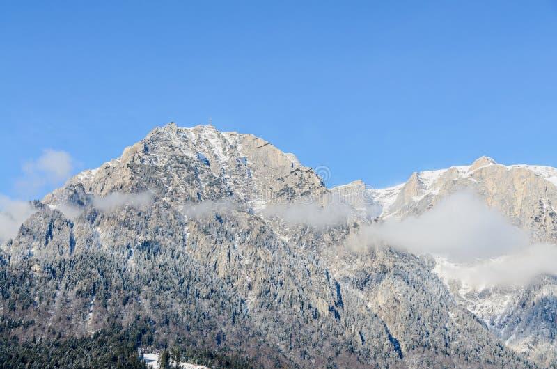 Romanian Carpathian mountains, Bucegi range with clouds, snow. And fog, winter time landscape stock image