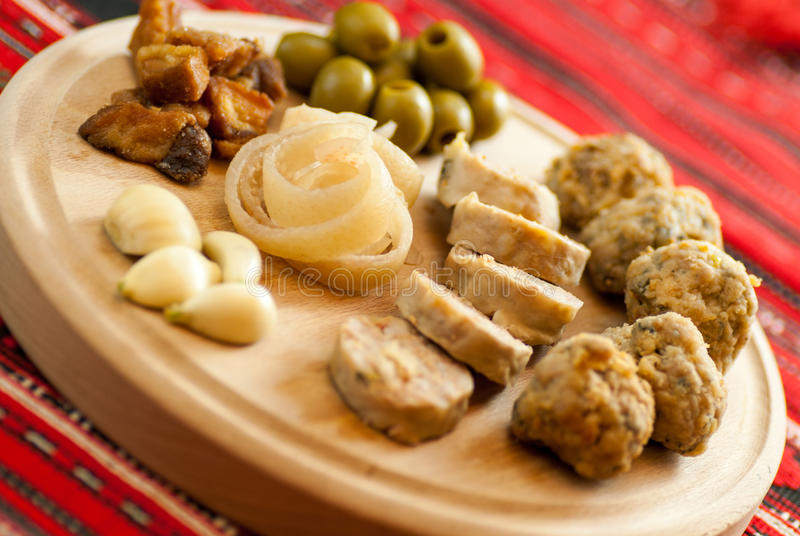 Romanian christmas appetizer consist of various pork dishes. On a plate stock image