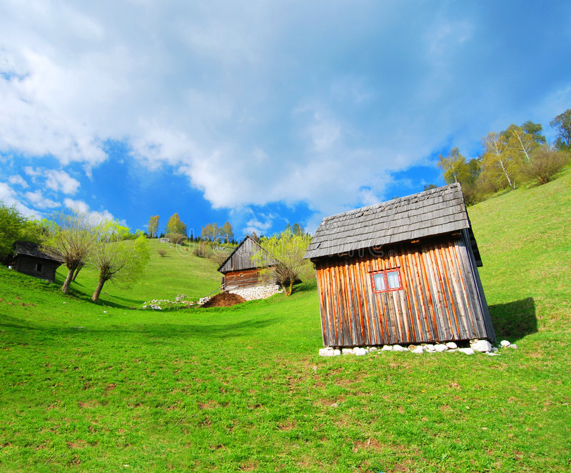 Romanian countryside chalets. Hillside chalets in countryside, Bran Moeciu de Jos, Transylvania, Romania stock photo