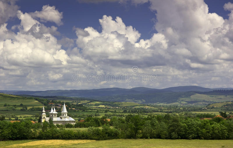 Romanian countryside - white church and rural land royalty free stock photo