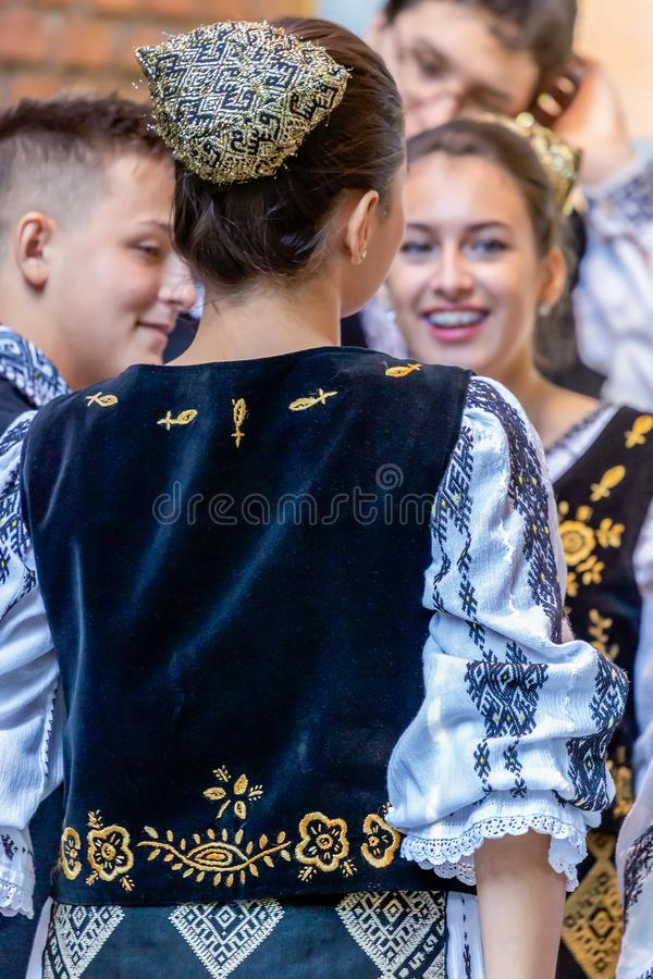 Romanian dancers in traditional costume. ROMANIA, TIMISOARA - SEPTEMBER 24, 2016: Romanian dancers in traditional costume perform folk dance during, Festival of royalty free stock photos