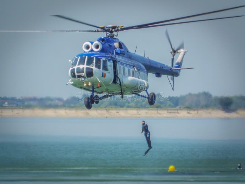 Romanian divers gendarmerie at Aeronautic show 2016 from bucharest crangasi lake,. Romanian gendarmerie divers tactical exercise at aeronautic show 2016 from royalty free stock photography