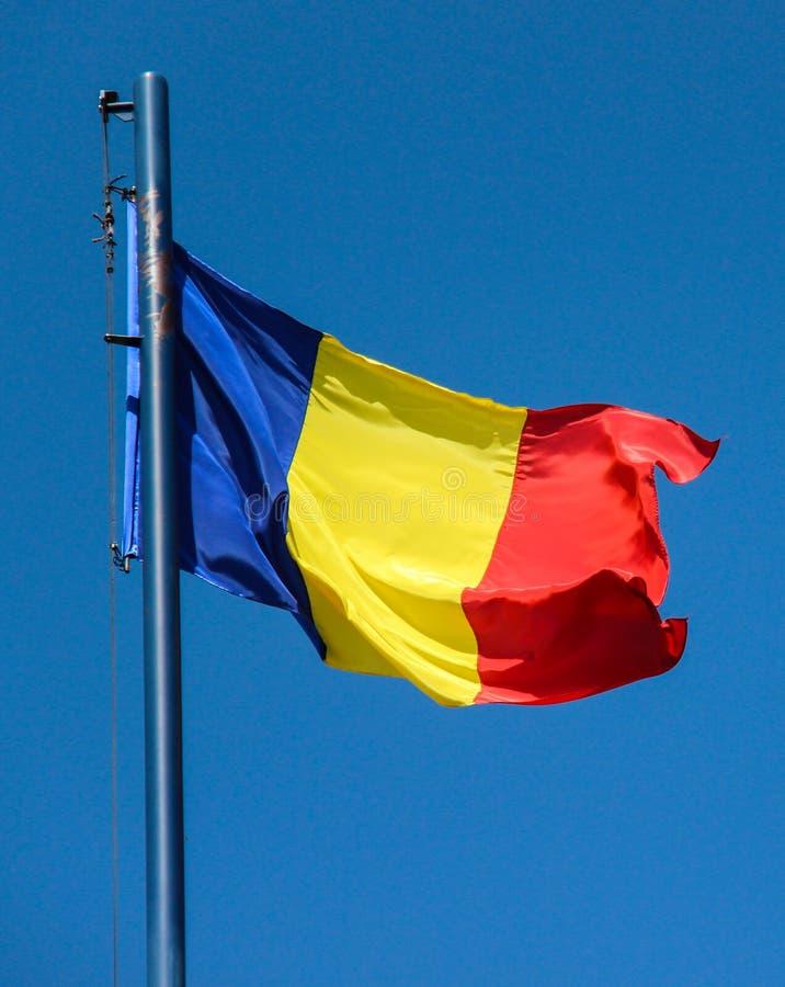 Romanian Flag. Romanian country flag on a pole royalty free stock photos