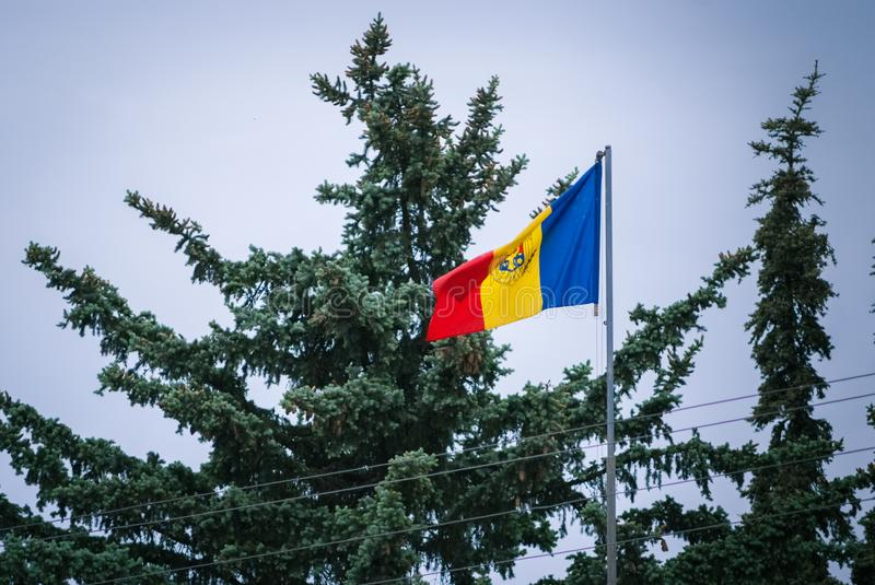 Romanian Flag on the mast. Romania flag of silk. Romanian flag on flagpole blowing in wind isolated against blue sky with copyspac. Romanian Flag on the mast royalty free stock photos