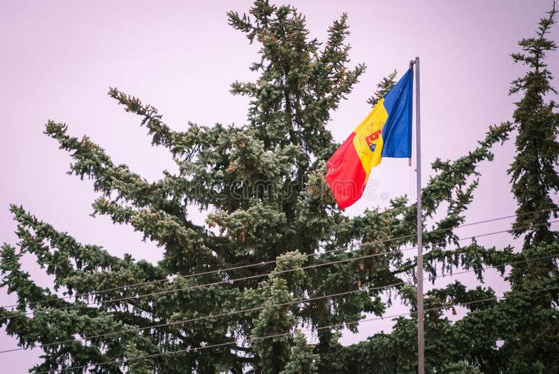 Romanian Flag on the mast. Romania flag of silk. Romanian flag on flagpole blowing in wind isolated against blue sky with copyspac. Romanian Flag on the mast royalty free stock photography