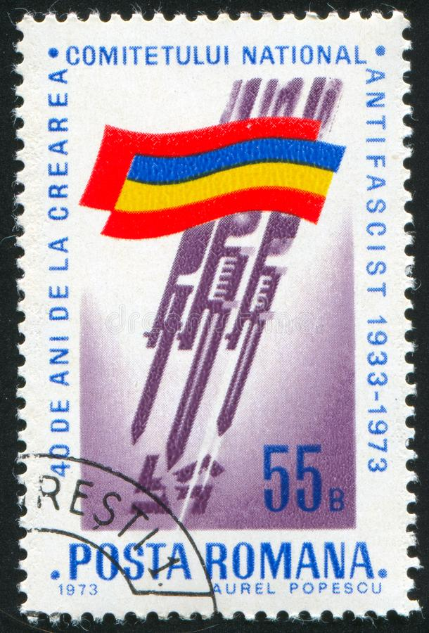 Romanian flag. ROMANIA - CIRCA 1973: stamp printed by Romania, shows athlete Romanian flag, Bayonets stabbing Swastika, circa 1973 stock photos