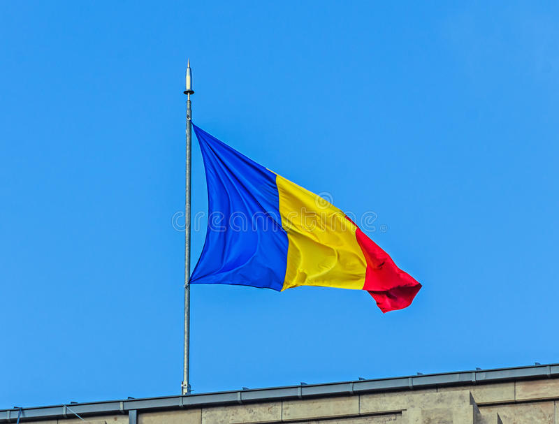 Romanian Flag in the sun, National Day of Romania. Blue sky close up stock photography