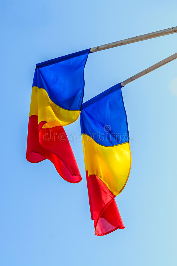 Romanian Flag in the sun, National Day of Romania, blue sky. Close up stock photography