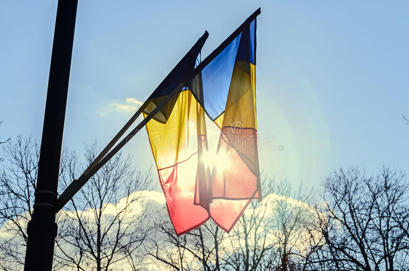Romanian Flag in the sun, National Day of Romania, blue sky. Close up royalty free stock photography