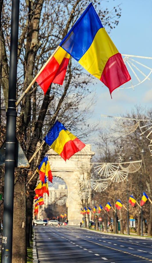 Romanian Flags in the sun, National Day of Romania. Blue sky close up royalty free stock photography