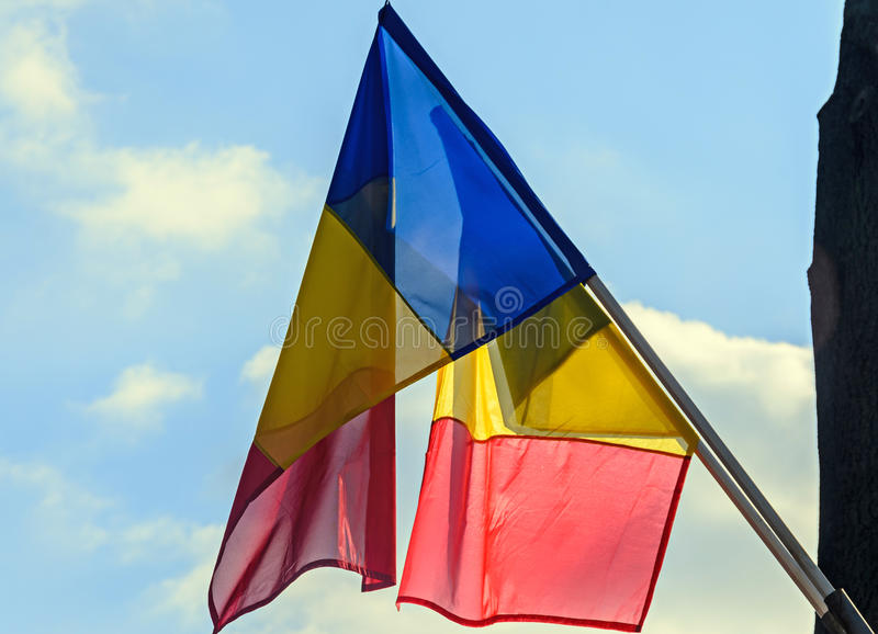Romanian Flags in the sun, National Day of Romania. Blue sky close up stock photography