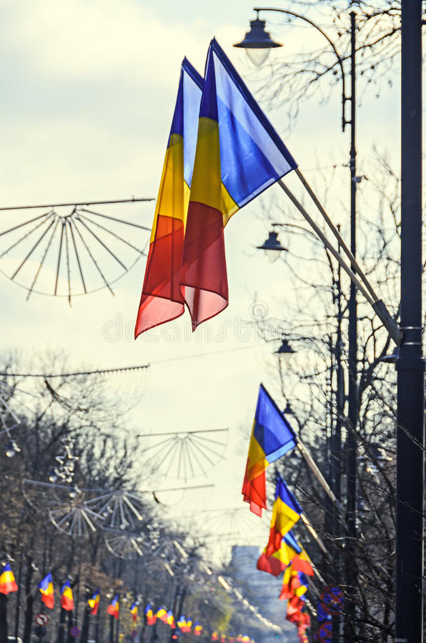 Romanian Flags in the wind, National Day of Romania, Kisselleff. Avenue, blue sky close up stock photography