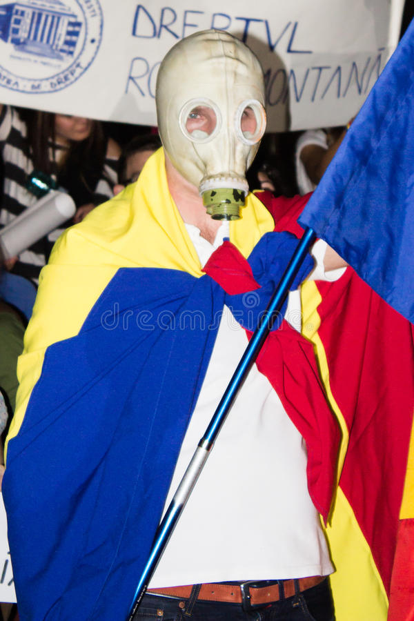 Romanian gas mask protester against Rosia Montana royalty free stock image